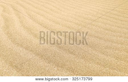 Close-up Of Sand Background Texture. Stock Photos.