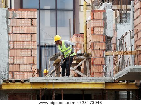 Pomorie, Bulgaria - September 27, 2019: New Construction Site. Workers Build A Home.