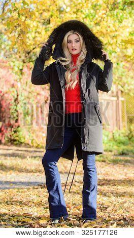 Girl Wear Parka While Walk Park. Puffer Jacket With Hood. Woman Wear Black Parka Fur Hood. Youth Hip