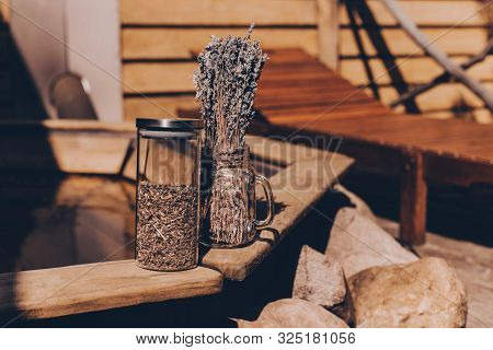 Dried Herbs In Glass Jars On A Wooden Pool Background. Copy Space For Text. Beauty Blogger, Salon Th