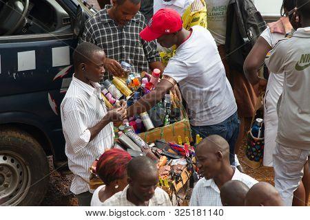 Kampala, Uganda - October 03, 2012.  A Man Sells Wallets To Passengers At The Taxi Park In Kampala,