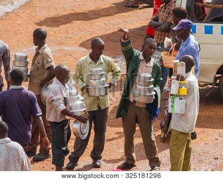Kampala, Uganda - October 03, 2012.  Salesmen Having A Conversation While Working At The Bus Station
