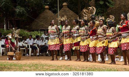 Kampala, Uganda - October 03, 2012.  A Group Performs A Song And Dance Outside The Kampala National
