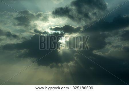 Stormy Gloomy Sky With Sun Breaking Through