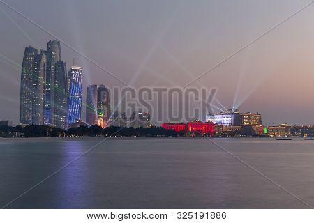 Abu Dhabi, Uae - December 1, 2017: Abu Dhabi Skyline With Emirates Palace And Etihad Towers Lit Up F