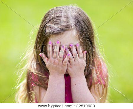 Adorable Girl Playing Peek A Boo