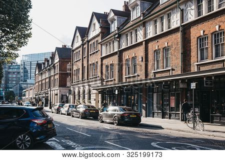 London, Uk - September 07, 2019: Cars Parked Pon Road Near Shops And Cafes In Spitalfields Market, O