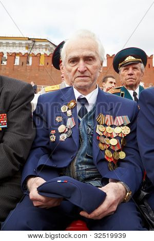 MOSCOW - MAY 9: World War II veteran Irakly Georgievich on Victory Day celebration on Red Square, May 9, 2011, Moscow, Russia. Veteran is awarded with numerous of military orders and medals.