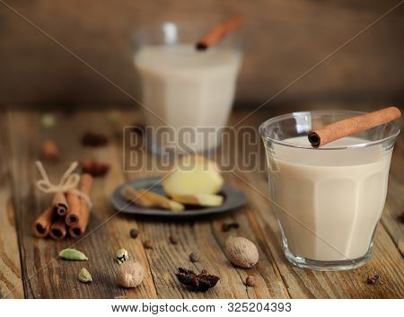 Masala Tea In A Glass.traditional Indian Drink Masala Chai Tea With Milk And Spices Cinnamon Stick,