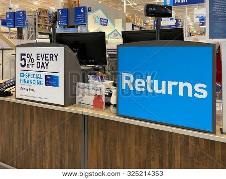 Orlando,fl/usa-10/1 /19: The Sign At Lowes Home Improvement Store That Reads Returns.