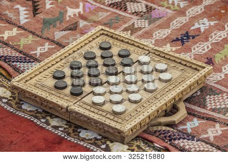 Medieval Checkers Or Draughts. Board Game Made With Old Midde Ages Muslim And Christian Coins Over P