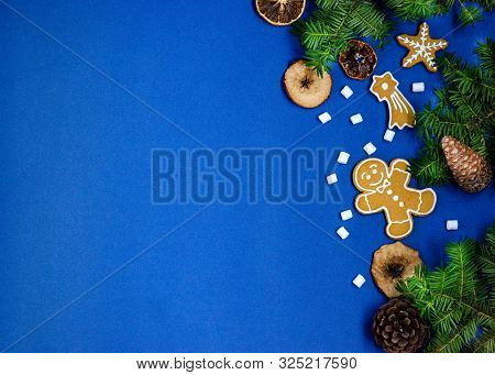 Bright Christmas Or New Year Blue Background With Branches Of Spruce, Christmas Gingerbread Cookies,