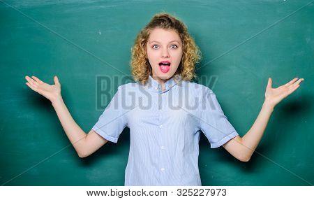 Woman Teacher In Front Of Chalkboard. Teacher Explain Hard Topic. Teacher Best Friend Of Learners. G