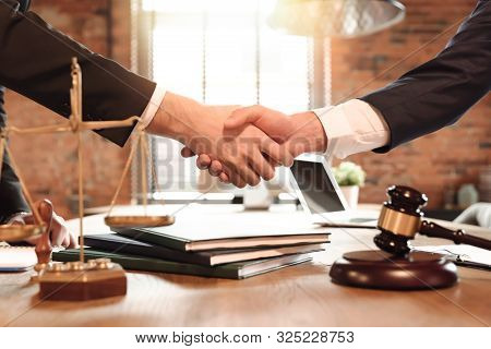 Lawyer And His Client Handshake. Agreement With Attorney In Office. Law And Justice Concept