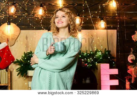 Christmas is by far most awaited for holiday of year. Girl with mug of hot beverage relaxing. Things to do before christmas. Woman drink tea christmas decorations background. Relax and recharge poster
