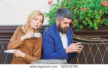 Couple Cafe Terrace Drink Coffee. Couple In Love Sit Cafe Terrace Enjoy Coffee. Man Secret Messaging