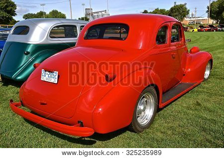 Yankton, South Dakota, August 16, 2019: A Classic Red Restored 1939 Chevrolet Coupe Is Displayed At