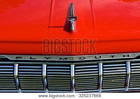 Yankton, South Dakota, August 16, 2019: A Classic Red Restored Plymouth 1964 Sport Fury Car Grill An