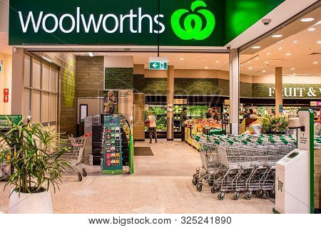 Sydney, Australia 08-31-2019: Entrance And Exterior View Of Woolworths Supermarket. Shopping Trolley