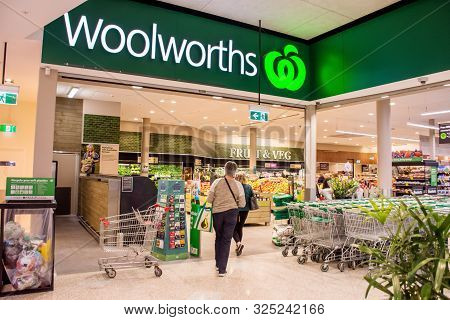 Sydney, Australia 08-31-2019: Entrance And Exterior View Of Woolworths Supermarket. Two Female Custo