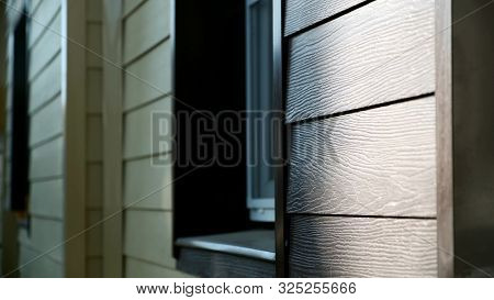 Decoration Of Houses With Siding. Stock Footage. Wooden Facing Of Facade Of House. Beautiful Facade