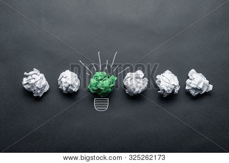 Light Bulb Sketch Drawing With Crumpled Green Paper Ball On Blackboard. Successful Solution Of Probl