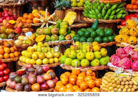 Tropical Fruits On The Famous Market In Funchal, Madeira Island, Portugal. Exotic Fruit. Banana, Man