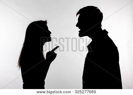 Aggression And Abuse Concept - Man And Woman Expressing Domestic Violence In Studio Silhouette Isola
