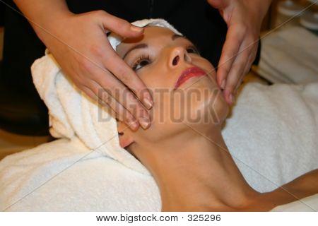 Woman Receives Facial