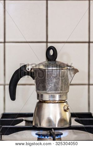 Classic Italian Style Moka Coffee Pot On The Gas Stove With Fire, Italian Style