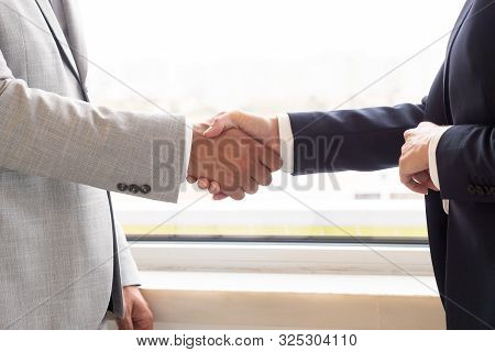 Business People Shaking Hands. Close-up Partial View Of Professional Businessman And Businesswoman S