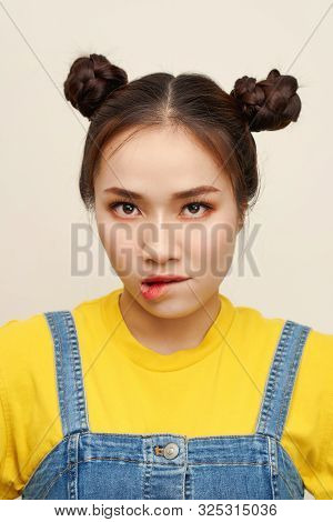 Close Up Photo Beautiful Amazing She Her Lady Two Hair Buns Bite Lip Oh No Sorry Guilty Despair Expr