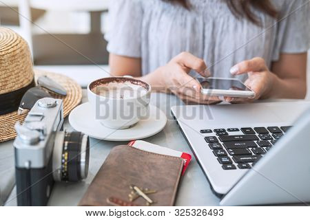 Young Traveler Planning Vacation Trip And Searching Information Or Booking Hotel On Laptop And Smart