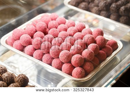 Chocolate Balls With Pink Glaze. Sweets On Showcase
