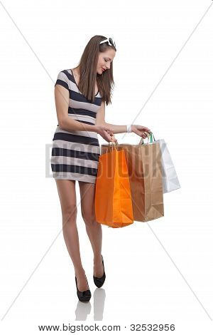 Cute woman shopping with bags