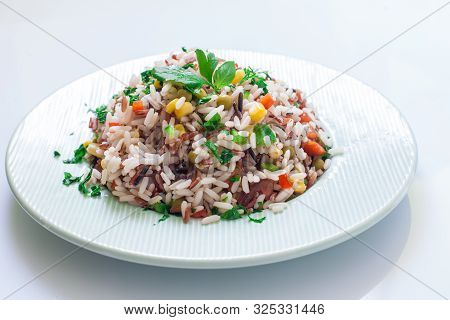 Vegetarian Rice Salad Only With Veggies And Herbs