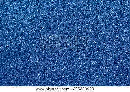 A Blue Background With Blue Glittery Paper