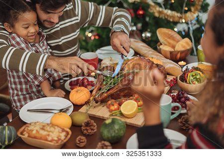 Happy Family Celebrating Thanksgiving Dinner At Home  .thanksgiving Celebration Tradition Concept