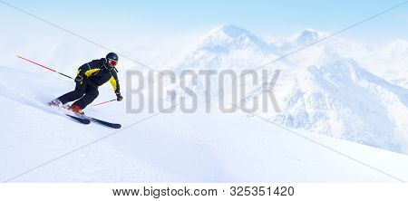 Alpine Skier In High Mountains Skiing Downhill On Piste Copy Space For Text , Sli Slope, Ski Resort,