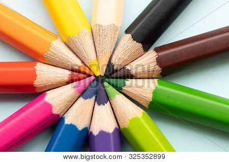 Top View Of Colourful Crayons Or Colour Pencil Set In Range Isolated On Pastel Indigo Blue Backgroun