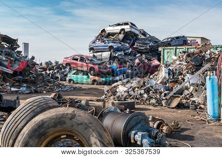 Old Cars In Landfill. Garbage Pile In Trash Dump Or Landfill. Pollution Concept.