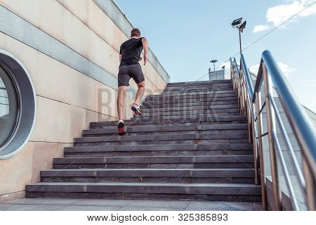 Man Runs Up Stairs, View From Back, In Summer, Autumn Spring In City, Free Space For Motivation Text