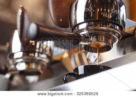Coffee Machine Preparing Fresh Espresso Through The Bottomless Portafilter. Coffee Extraction. Delic