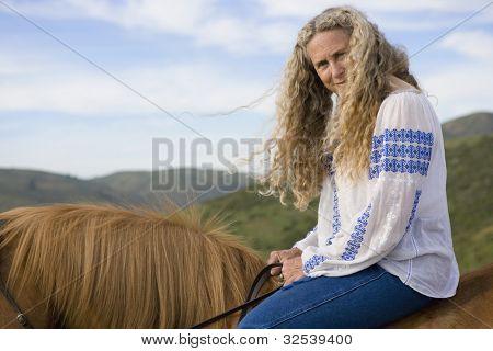 Senior woman horse riding bareback