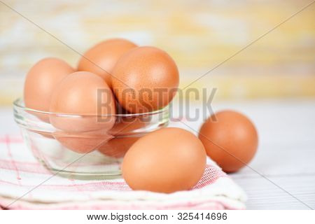 Fresh Egg Glass Bowl On The Wooden Table Background / Raw Chicken Eggs Collect From The Farm Product