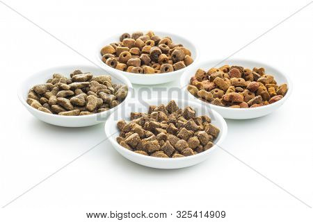 Dry kibble pet food in bowl. Kibble for dog or cat isolated on white background. poster
