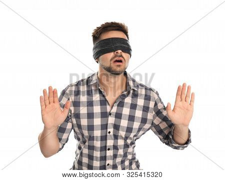 Young Man With Black Blindfold On White Background
