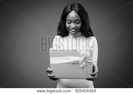 Young beautiful African Zulu businesswoman against brown background poster