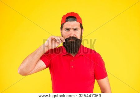 Feeling Awesome. Moustache Grooming Guide. Hipster Handsome Guy Touching Moustache. Tips For Growing