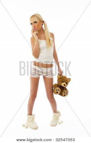 Beautiful Cute Young Blonde Girl Wearing Pajamas Holding A Teddy Bear